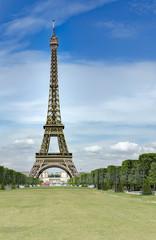 Eiffel Tower from Champ de Mars, Paris, France. Beautiful Romantic background, no people, vertical