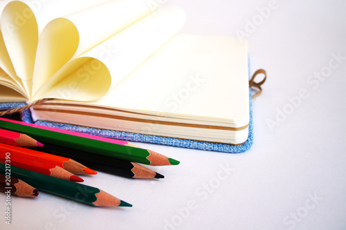 The Opened Notebook With The Pages Wrapped In A Circle And Multi