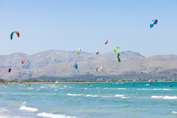 Alcudia, Mallorca - A sky full of kites at the farsighted beach of Alcudia