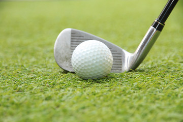 Golf ball and golf club in grass swing shot