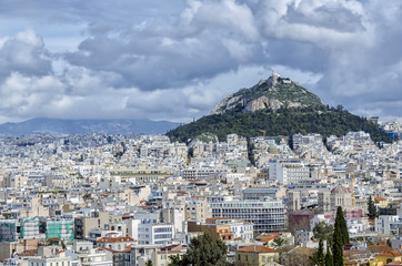 Lycabettus, is a cretaceous limestone hill in Athens, Greece. Pine trees cover its base, and at its two peaks are the 19th century Chapel of St. George, a theatre, and a restaurant