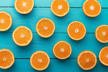 Summer. Fresh orange on blue wooden background. Mock up