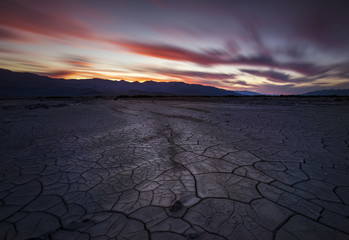 Sunset over beautiful mud cracks out in the desert
