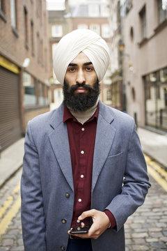 Street portrait of a Sikh businessman in London