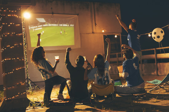 Friends watching a football match