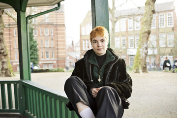 Portrait of a young white female in urban park