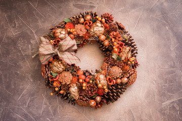 Christmas wreath with cones and dried fruit, toned gold, on the vintage background