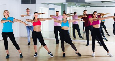 friendly men and ladies dancing aerobics at lesson