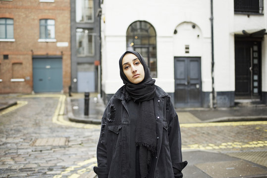 Portrait of a young Muslim woman in a city street