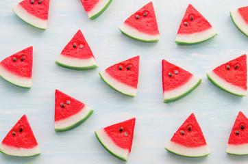 Red watermelon slice pattern on blue wooden background