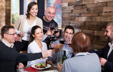 Company celebrating in restaurant