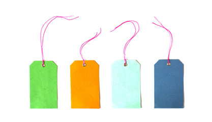 Blank colorful tag tied for hang on product for show price or discount isolate on white background