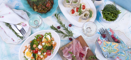 Holiday dinner. Food of Holland. Sandwiches with herring ham and snacks, wine, salad. seafood. Delicious.