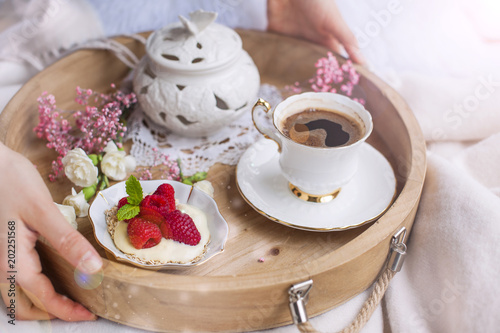A Woman Is Drinking Coffee In Bed Wooden Tray With Breakfast Raspberry Berries