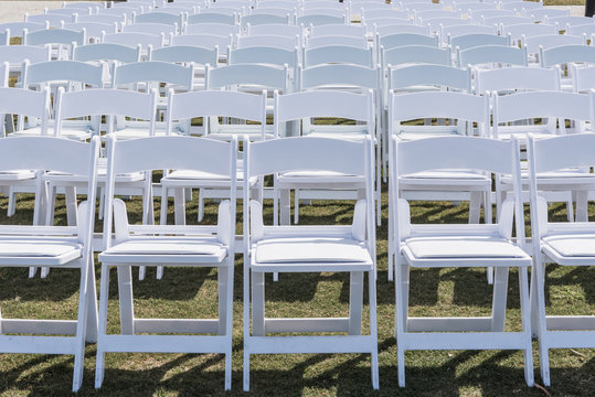 White Chairs Set Up for Wedding