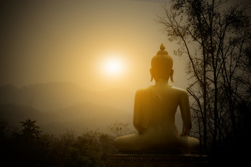 Poster Boeddha Buddha Statue on the mountain with sunset background