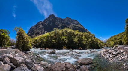 Panoramic View of Cleddan River next to Falls Creek Waterfall in Fiordland National Park on the way to Milford Sound in New Zealand, South Island.