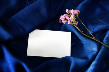 Navy blue silk and white paper. Theme for luxurious classic. Start idea for everything design