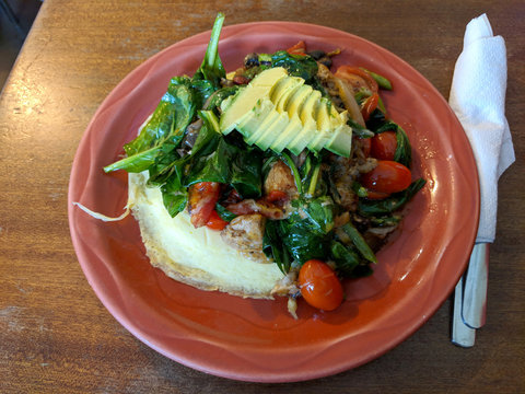Omelette with Avocado, tomatoes, spinach, and asparagus on top
