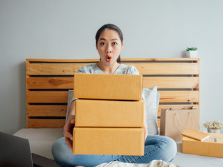 Woman is feeling surprised with the product boxes.