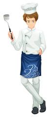 Chef holding a kitchen utensil
