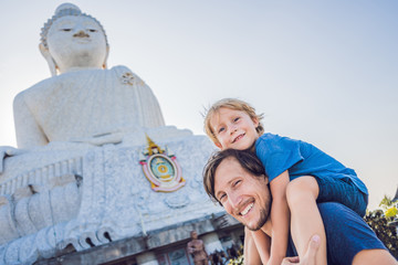 Father and son tourists on the Big Buddha statue. Was built on a high hilltop of Phuket Thailand Can be seen from a distance