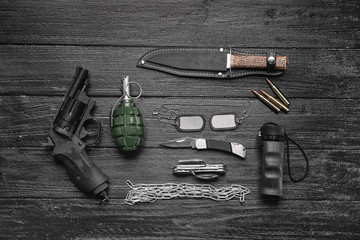 Set of military outfit on wooden background, flat lay