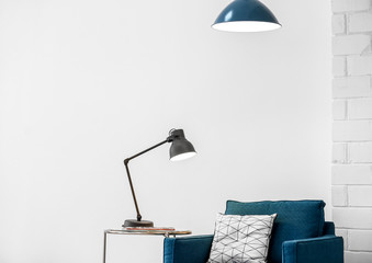 Modern lamps with blue armchair indoors