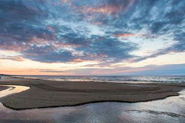 A horizon line, sunset on the beach. Sea, sand, sky. Island concept. Scenic cosmic seascape