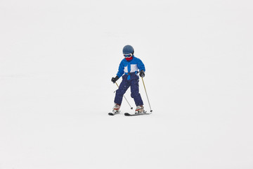 Children skiing under the snow. Winter sport. Ski slope