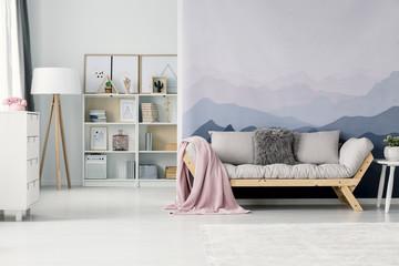 Pink blanket on beige sofa