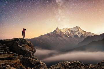Foto auf Gartenposter Beige Photographer traveler who take a picture of starry sky and sunrise in mountains