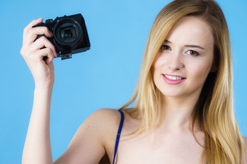 Young woman holding old fashioned camera