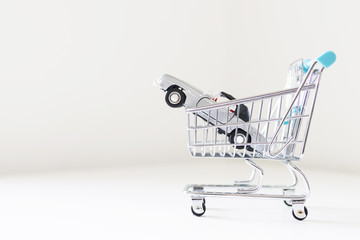 shopping cart with car, concept of buying car