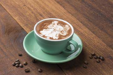 angel coffee art with dark background