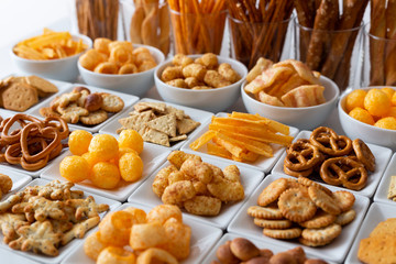 Photo sur Toile Buffet, Bar Rows of many types of savory snacks in white ceramic dishes.