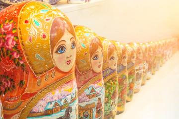 Vintage Russian matryoshka nesting dolls row lined on table.