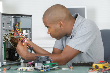 Man working on computer internals