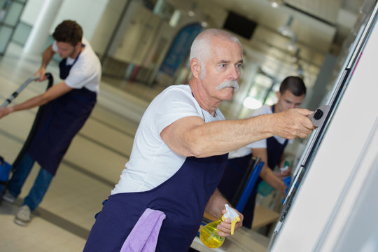 senior janitor at work