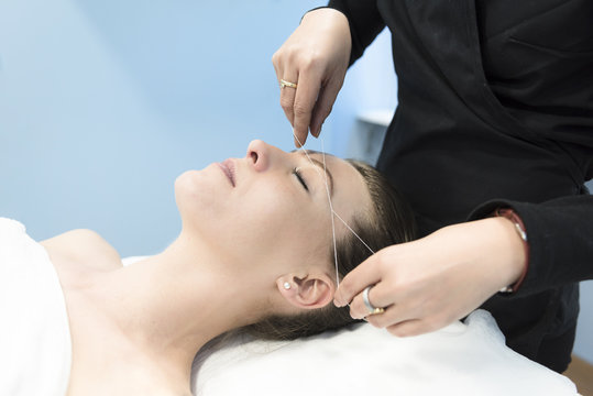 woman in a Threading