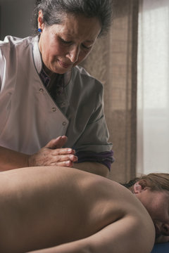 Therapist giving oriental massage to a woman