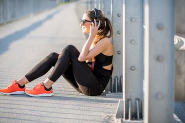 Sports woman resting on the bridge