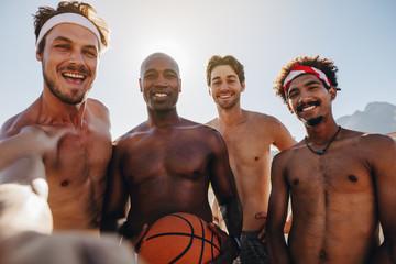 Basketball players posing for photo