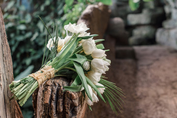 wedding bouquet with white tulips and palm leaves