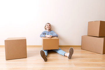 Image of young woman with cardboard box