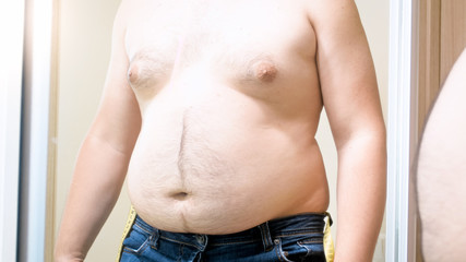 Closeup photo of fat man with big belly and breast