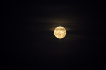 Yellow full moon at night with glow. Copyspace.