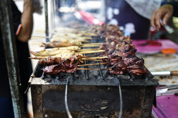 Street food in thailand. Meat snacks sold on the street in Thailand.