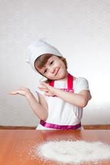 Девочка - повар танцует