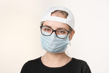 girl in medical mask with respirator on white background.